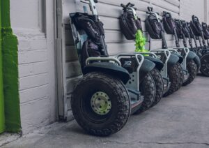 Segways lined up along a wall
