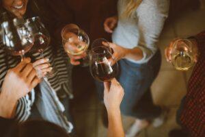 Girls holding glasses of wine