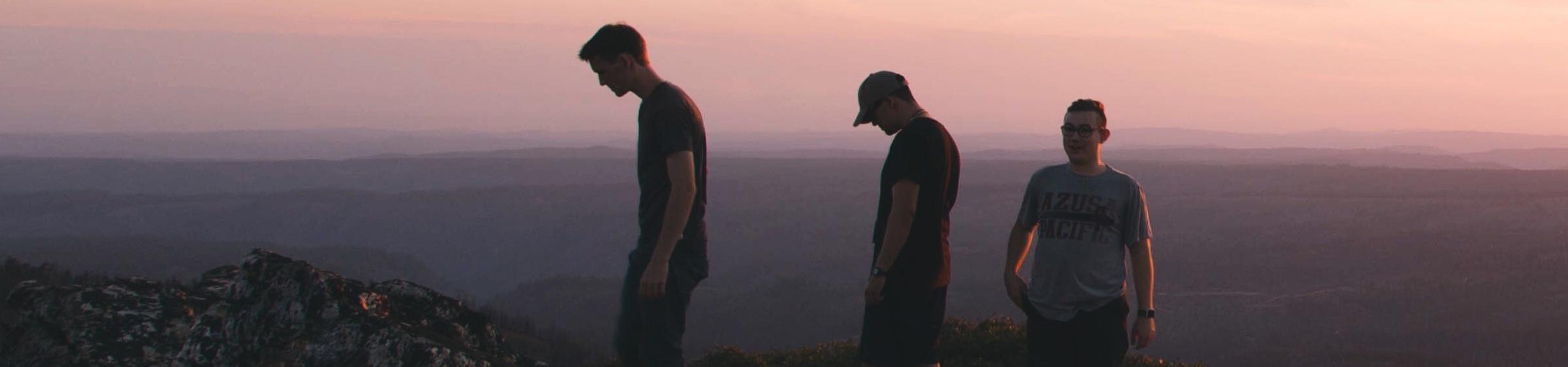 Three men looking at a view