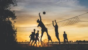 Group of lads playing volley ball